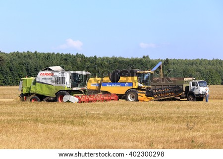 Tatarstan, Russia - August 15 2015: Hot Harvest in the vast fields of Tatarstan on a sunny summer day.