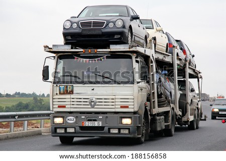 TATARSTAN, RUSSIA - AUGUST 20, 2011: White Renault Manager car carrier at the interurban road. - stock photo