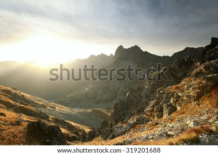 Tatra Mountains at sunrise in late September. - stock photo