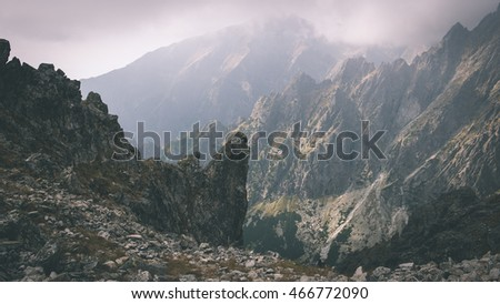 Tatra mountains in Slovakia covered with clouds. summer colors - vintage film effect