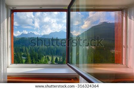 Tatras from window at day - stock photo