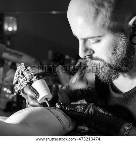Tattoo artist making a tattoo