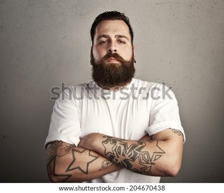 Tattooed man wearing white t-shirt - stock photo