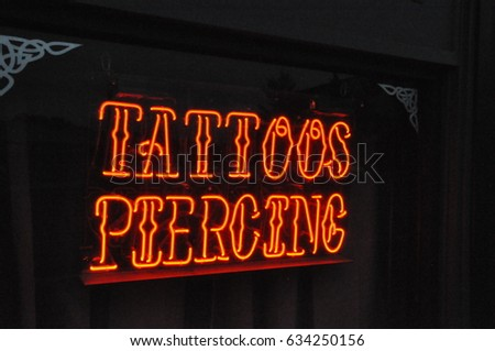 Tattoos / Piercings neon sign