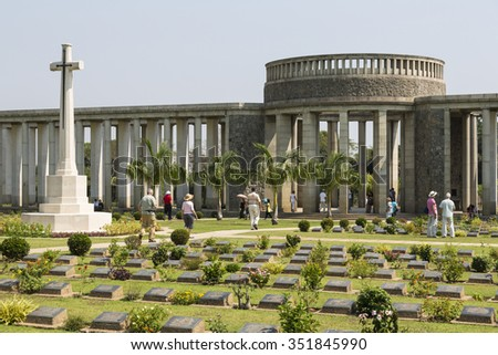 TAUKKYAN, YANGON/MYANMAR - FEBRUARY 07, 2015: Unidentified people visit Taukkyan war cemetery near Yangon. The cemetery contains the graves of 6,374 soldiers who died in the Second World War.
