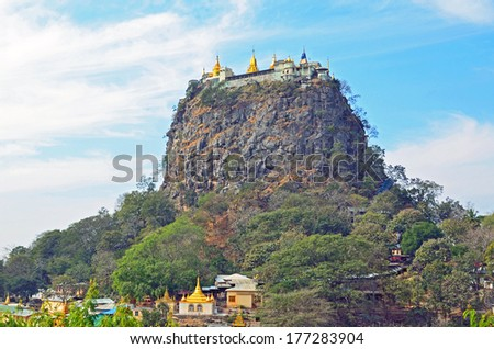 TAUNG KALAT, MYANMAR � JANUARY 29, 2014: Taung Kalat is a hill of Mount Popa and a Buddhist monastery is located at the summit of it. It rises 737 meters above the sea level. - stock photo