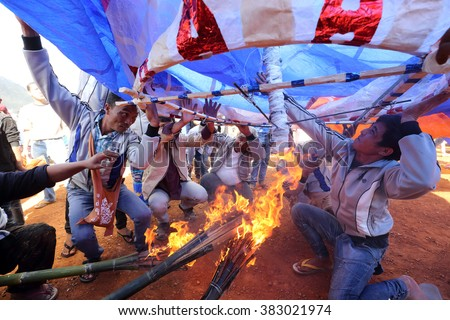 TAUNGGYI - MYANMAR - NOVEMBER 22, 2015: Unidentified Buddhist people attending the famous annual hot-air ballon festival on November 22, 2015 in Taunggyi, Myanmar. - stock photo