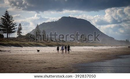 TAURANGA, NEW ZEALAND - JAN 7; People enjoying a summer day outdoors sunbathing and swimming at beach on January 7, 2015 at Mount Maunganui Beach, near Tauranga in New Zealand.