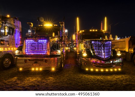Tauranga, New Zealand - January 23, 2016 Illuminated trucks on display at The Mount Truck Show. As night falls, the trucks take part in a night glow show with proceeds going to charity.