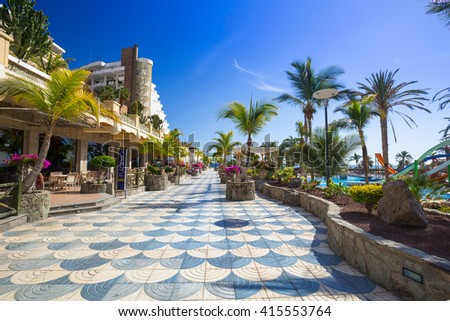 TAURITO, GRAN CANARIA, SPAIN - APRIL 21, 2016: Architecture of the Lago Taurito aquapark and hotels on Gran Canaria, Spain. Taurito is very popular tourist destination with many shops and hotels.
