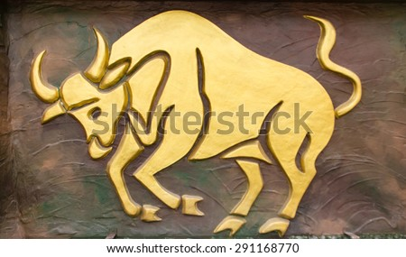 Taurus sign of horoscope on the wall - stock photo