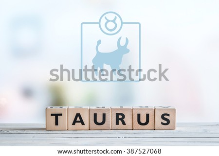Taurus star sign on a wooden table - stock photo