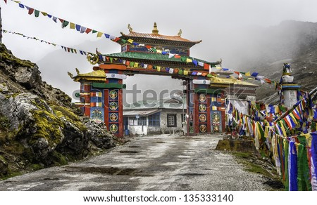Tawang, Arunachal Pradesh, India. Buddhist and tribal architecture as seen in this colourful gateway to Tawang at Sela Pass 13,700 ft above sea level in western Arunachal Pradesh on a misty morning. - stock photo