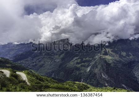 Tawang, Arunachal Pradesh, India. View of the high mountains and valleys and a glimpse of the main road connecting Assam in the south with Tawang in the north of western Arunachal Pradesh, India.