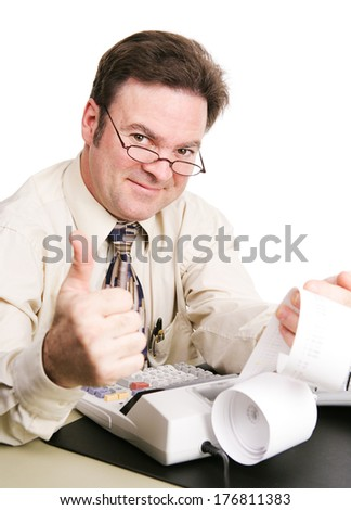 Tax accountant with his calculator, giving a thumbs up sign and smiling.  White background.