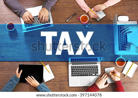 Tax concept. Business meeting at the table, top view - stock photo