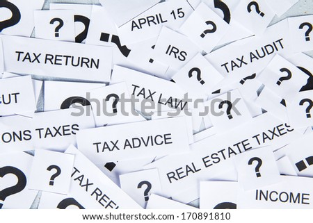 Tax concept with text of tax and question mark - stock photo