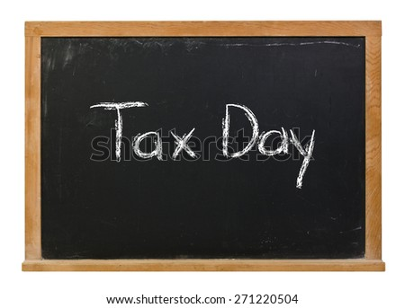 Tax day written in white chalk on a black chalkboard isolated on white - stock photo