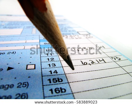 Tax documents for filing taxes in America with the IRS 1040 form and Pencil