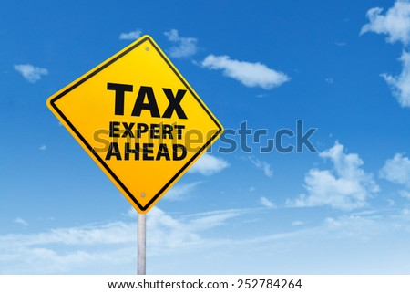 Tax Expert Ahead concept with a road sign under blue sky - stock photo