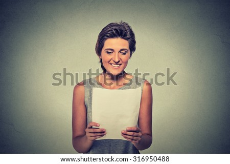 tax, finances, happiness concept. Smiling young woman with papers on gray wall background  - stock photo