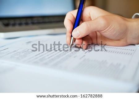 tax form analyzing - stock photo