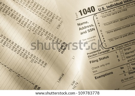 Tax form and operating budget - stock photo