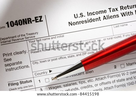 Tax form and pen - stock photo