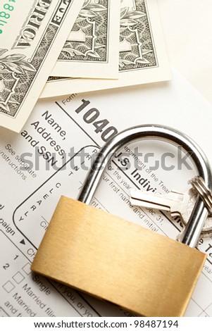 Tax form, dollars and key lock - stock photo