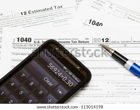 Tax form 1040 for tax year 2012 for US individual tax return with smartphone calculator - stock photo