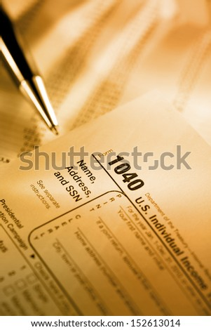Tax form, operating budget and pen - stock photo