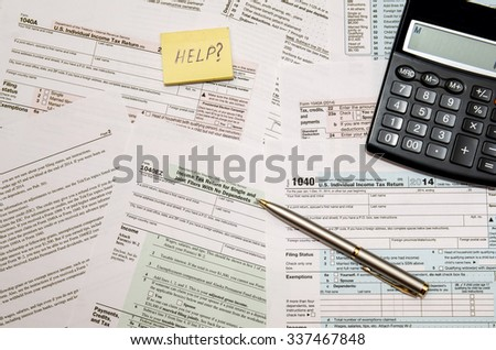 Tax Form 1040, U.S. Individual income tax return place with calculator and pen