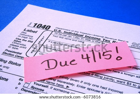 Tax form with a note taxes are due April 15 - stock photo