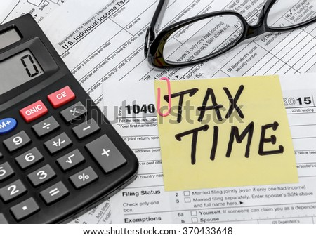 tax form with callculator and glasses - stock photo