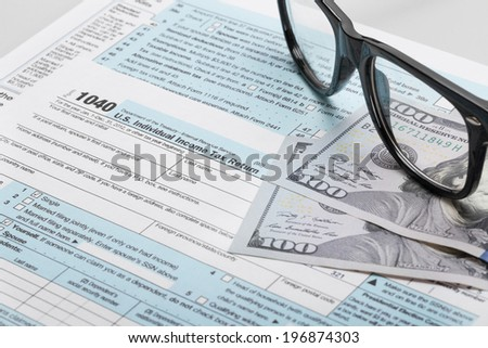 Tax Form 1040 with glasses