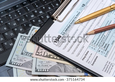 tax form 1040 with laptop