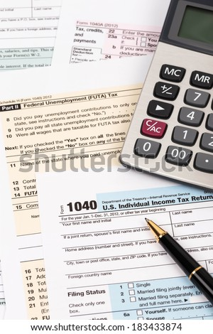 Tax form with pen and calculator taxation concept - stock photo