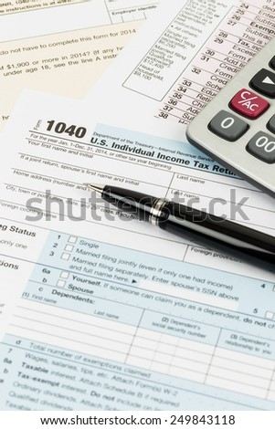 Tax form with pen, and calculator taxation concept