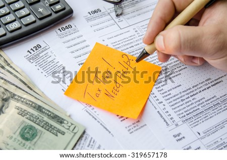 Tax form 1040, 1120, 1065  with pen, calculator and sticker - stock photo