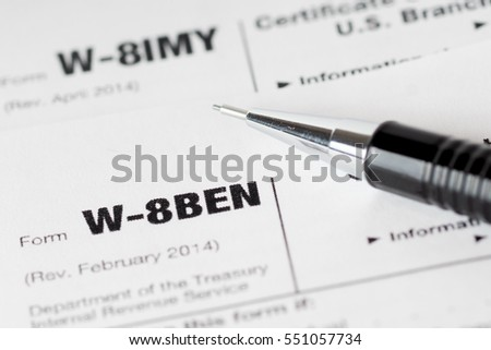 tax forms with black pencil