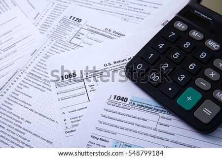 Tax forms 1040 with calculator