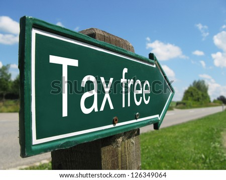 Tax free signpost along a rural road - stock photo