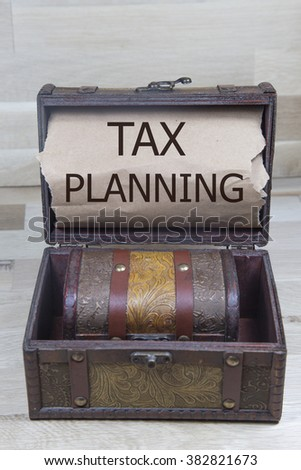 tax planing is written on the Brown torn paper in the treasure box. Tax Refund