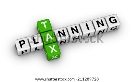 tax planning cubes crossword puzzle - stock photo