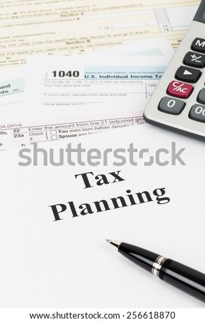 Tax planning with calculator taxation concept - stock photo
