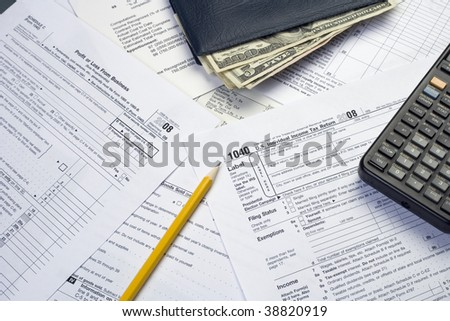 Tax related forms and tools are gathered together. - stock photo