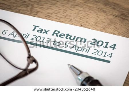 Tax return 2014 - stock photo