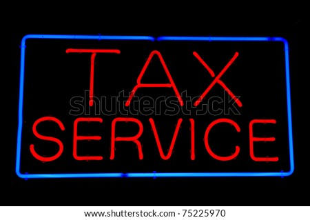 Tax Service Red Neon Sign - stock photo