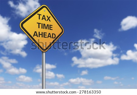 tax time ahead road sign and blue sky - stock photo