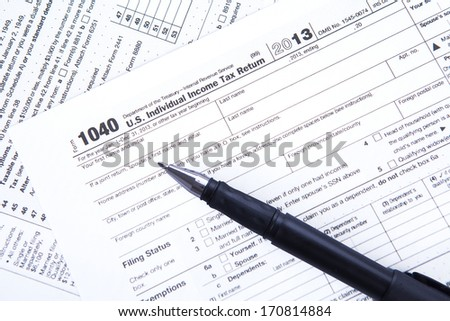 Tax time concept with an Official USA tax form - stock photo